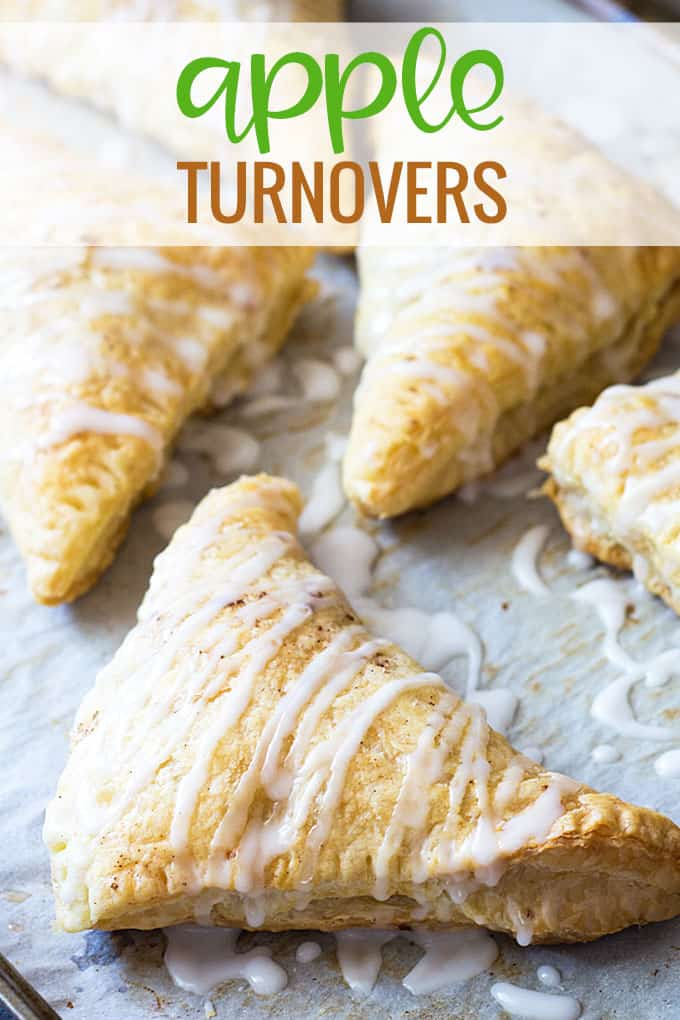 Closeup of apple turnovers drizzled with glaze on parchment paper with overlay text.