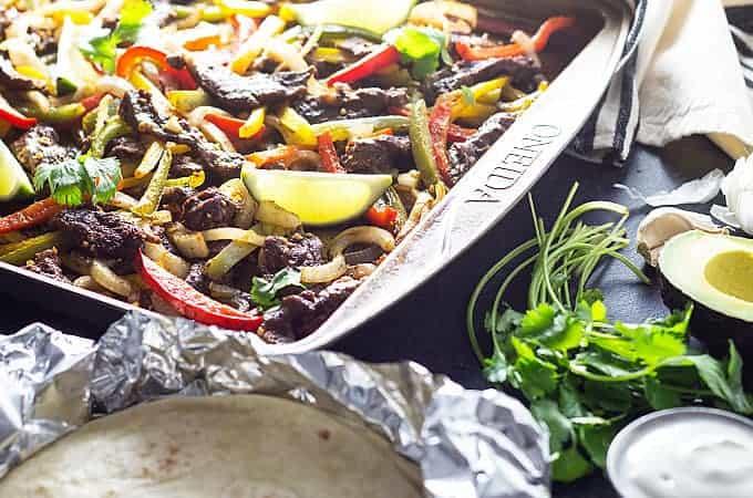 Sheet Pan Steak Fajitas - Perfectly seasoned and tender steak, peppers and onions in one pan!
