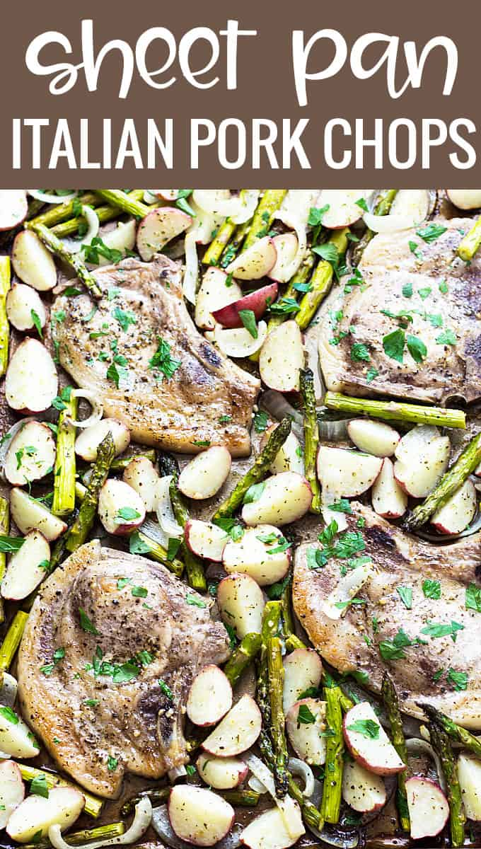 Overhead closeup of baked pork chops with asparagus and potatoes in a sheet pan.