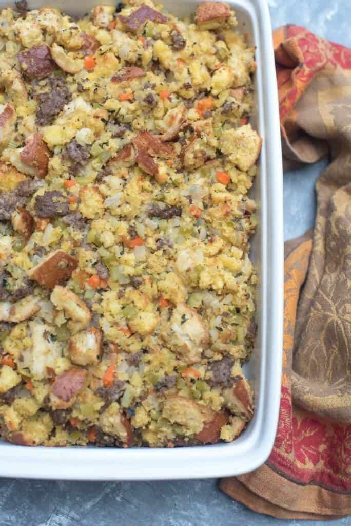Overhead view of cornbread stuffing in a white baking dish.