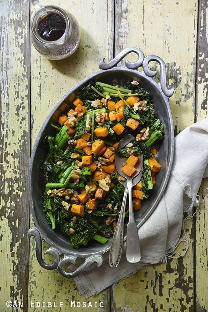 Overhead view of sweet potato and broccoli rabe salad in an oval pewter serving dish.