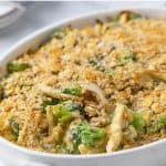 Chicken casserole in a white oval baking dish with overlay text.