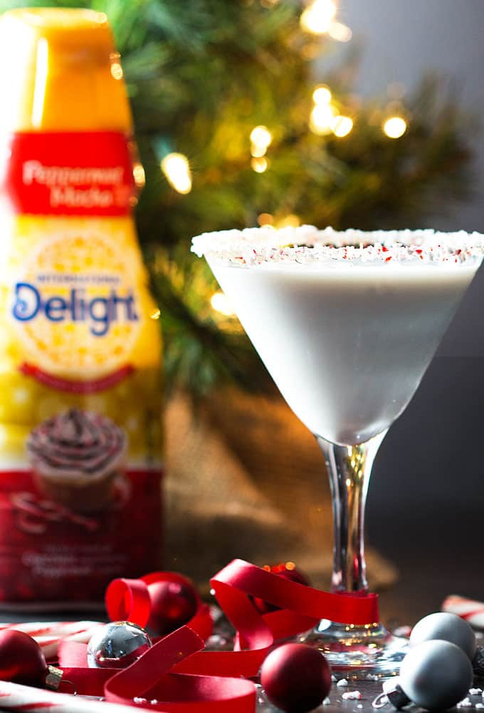 Front view of a martini.  A bottle of coffee creamer is in the background.