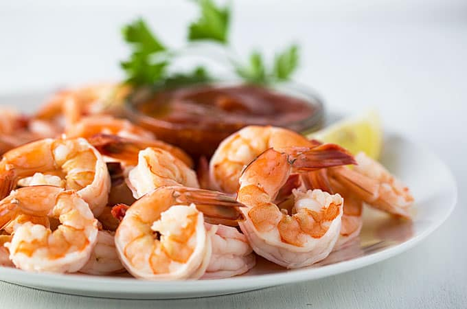 Front closeup view of shrimp on a white plate.