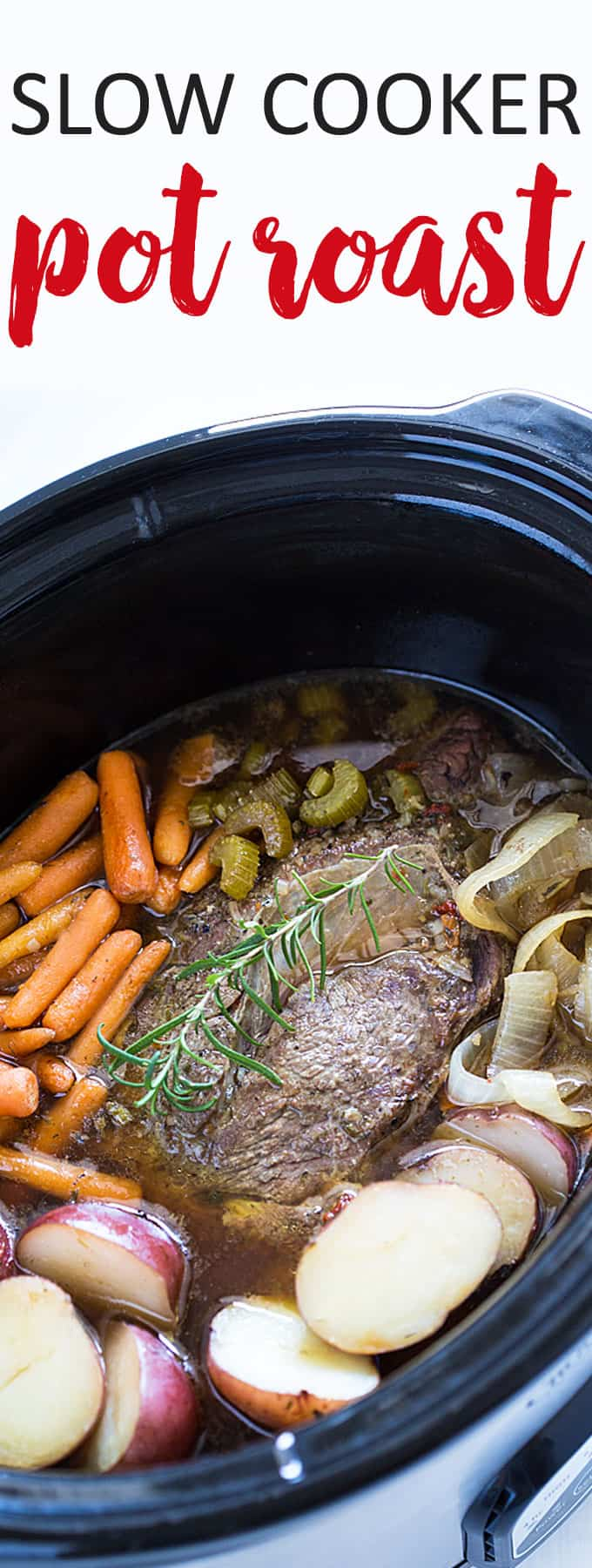 A cooked roast with vegetables in an oval slow cooker.
