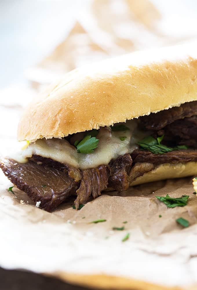 Slow Cooker French Dip Sandwiches - The most flavorful and tender french dip sandwich you'll ever eat!