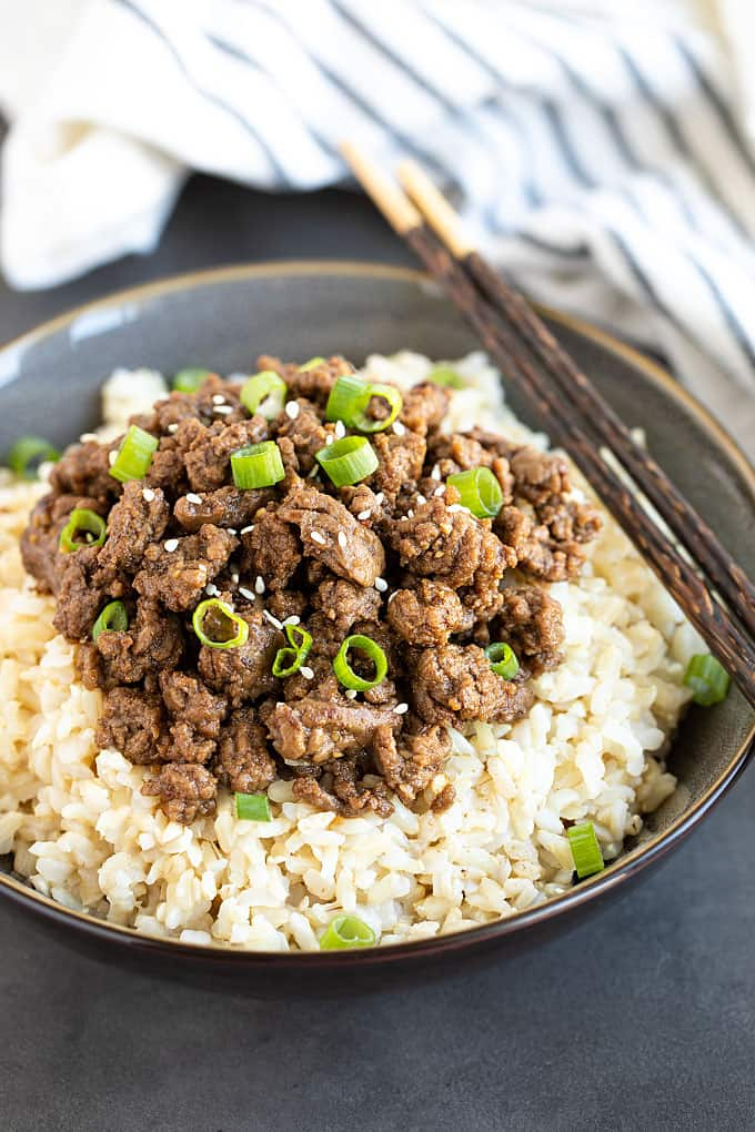 Korean ground beef bowls with rice in a bowl with chopsticks.