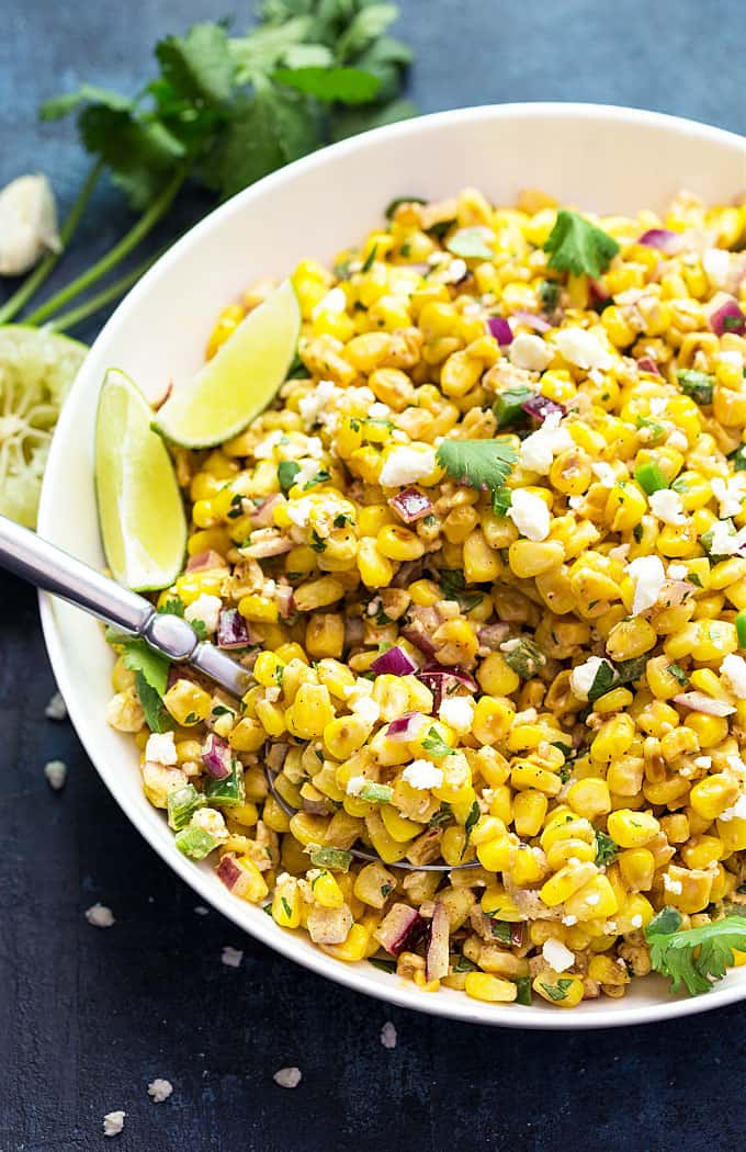 Mexican Corn Salad - Creamy, cheesy and perfectly seasoned corn with red onions and jalapenos.