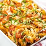 Chicken Caprese Pasta Casserole - Chicken meets caprese and pasta in this cheesy casserole!