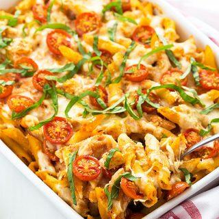 Chicken Caprese Pasta Casserole - Chicken meets caprese and pasta in this cheesy casserole!