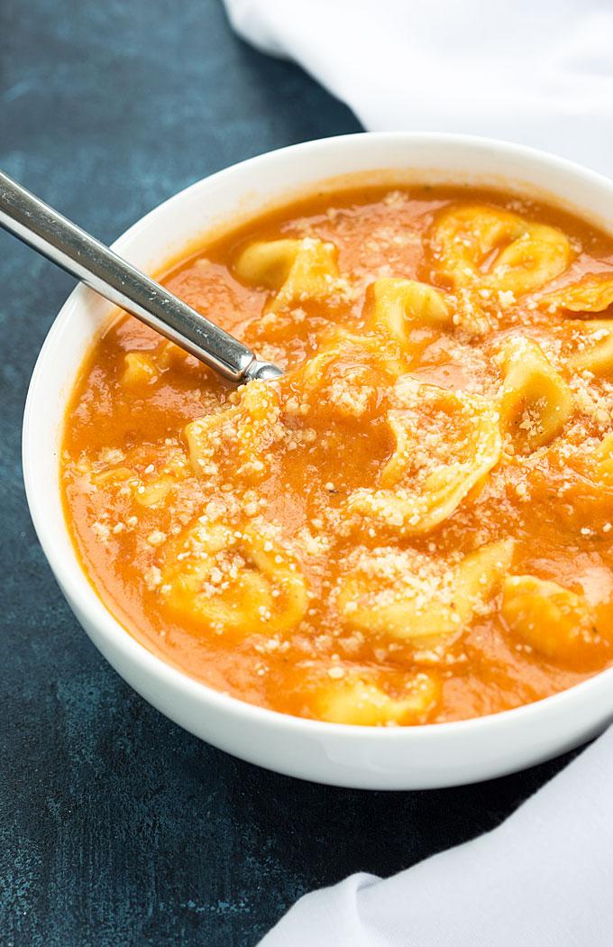 Creamy Tomato Tortellini Soup - Rich and creamy tomato soup full of cheesy tortellini.