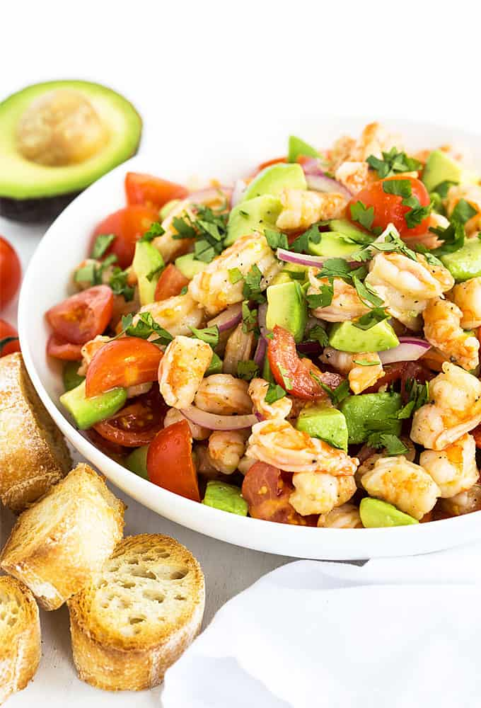 Shrimp and Avocado Salad - Shrimp, avocado, tomatoes and red onions in a zesty homemade vinaigrette. So healthy and refreshing!