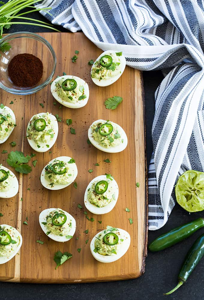 Guacamole Deviled Eggs - Deviled eggs stuffed with a creamy guacamole filling.