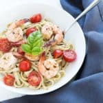 Buttery Shrimp over Pesto Pasta – Buttery shrimp with tomatoes over a pesto-seasoned pasta… a complete meal in under 20 minutes!