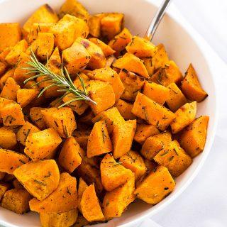 Roasted Rosemary Sweet Potatoes - Sweet and savory roasted sweet potatoes seasoned with fresh rosemary and nutmeg.