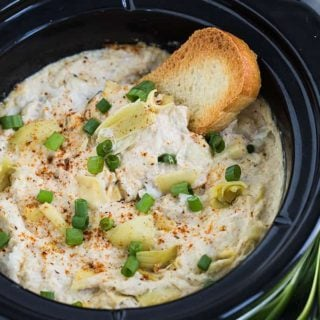 Slow Cooker Crab and Artichoke Dip - Perfectly seasoned, creamy and cheesy crab and artichoke dip prepared in your slow cooker.
