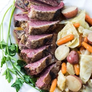 Instant Pot Corned Beef and Cabbage - The most tender and flavorful corned beef, cabbage and veggies prepared in your pressure cooker!