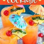 Three cocktails garnished with pineapple, orange, cherries and umbrellas.