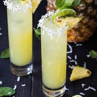 Pineapple Coconut Mojitos - So sweet, tart and refreshing... these delicious mojitos are a breeze to make!
