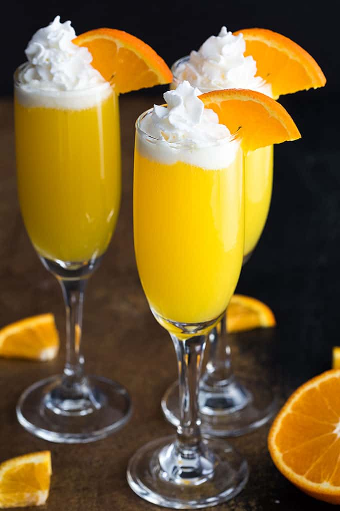Vodka Creamsicle Mimosas - Whipped vodka, orange juice and champagne come together in one of the most sinfully delicious mimosas!