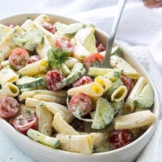 Creamy Cucumber and Tomato Pasta Salad with an easy homemade sweet and tangy dressing.