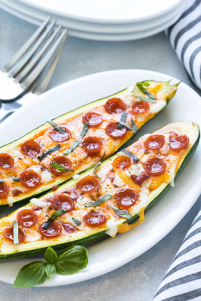 These Pizza Zucchini Boats are so easy to make, low-carb and amazingly delicious. Customize them with your favorite pizza toppings for a healthier pizza night!