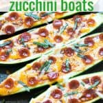 Zucchini pizza boats topped with pepperoni on a baking sheet.