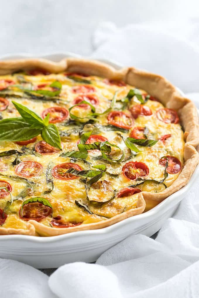 Caprese Quiche - An easy Italian-inspired quiche with tomatoes, basil, mozzarella and Parmesan that is bursting with flavor!