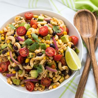 This Southwestern Pasta Salad is packed with healthy veggies and coated with the most flavorful southwestern dressing... it's the perfect side dish for your next potluck or cookout!