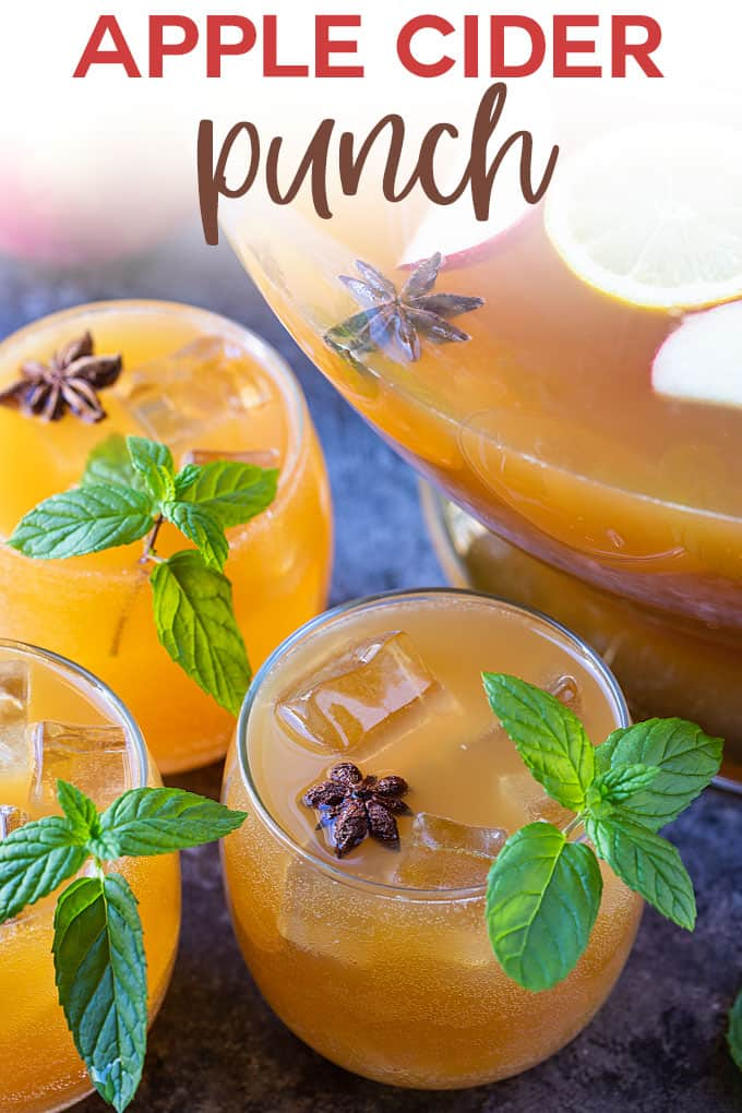 Three glasses of apple cider punch beside a punch bowl.  Overlay text at top of image.