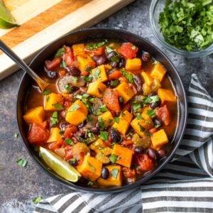 Overhead closeup of a black bowl of sweet potato chili.