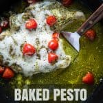 Baked pesto chicken in a skillet with overlay text.