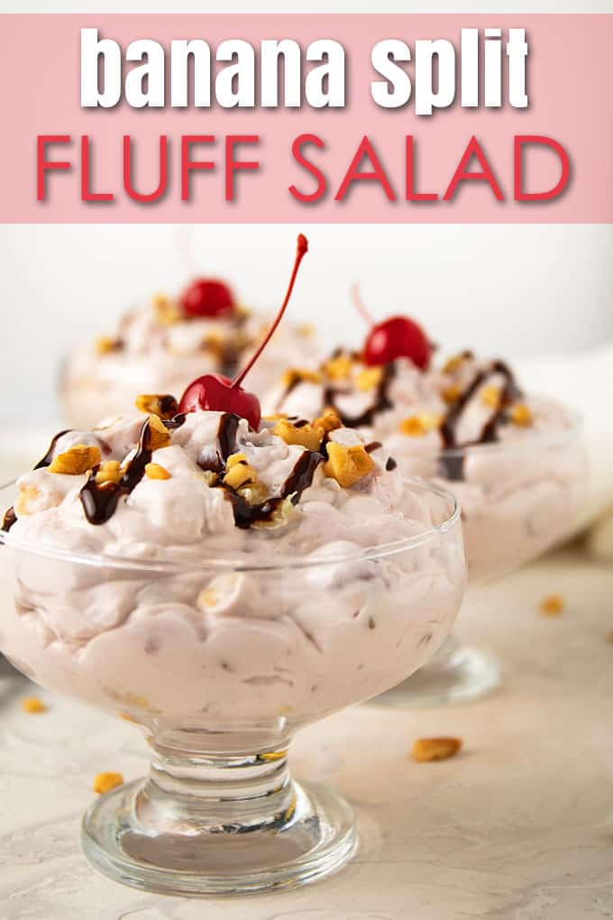Banana split fluff salad drizzled with chocolate syrup and topped with a maraschino cherry in 3 clear dessert dishes.