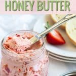Strawberry honey butter in a jar with a spreader knife.