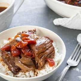 A bowl of rice topped with Italian Pot Roast and gravy cooked in the pressure cooker