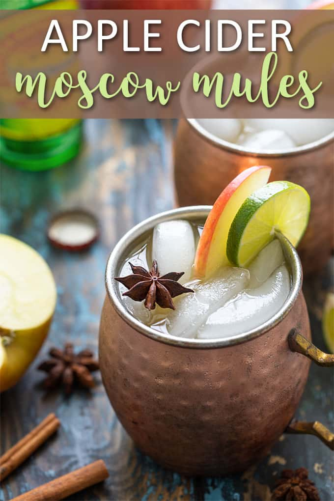 "Two Cider Mules in copper mugs. Text at top reads, ""Apple Cider Moscow Mules"""