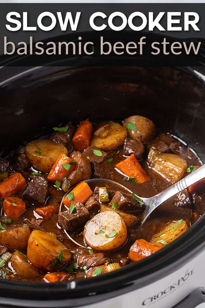 A ladle in a black crock pot insert with beef stew.