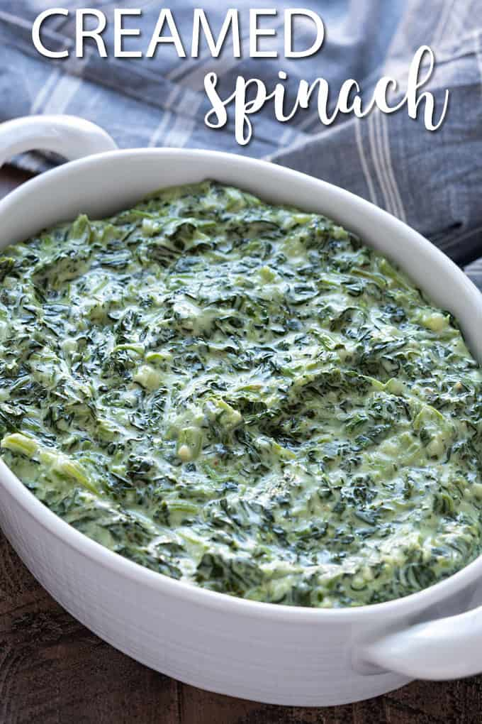 Creamed spinach in an oval white serving dish. Overlay text at top of image