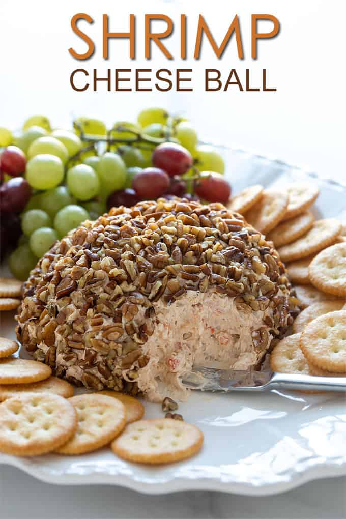 Shrimp Cheese Ball on a serving platter with crackers. Overlay text at top of image