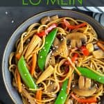 Overhead view of a bowl of lo mein with vegetables beside chopsticks. Overlay text at top of image.
