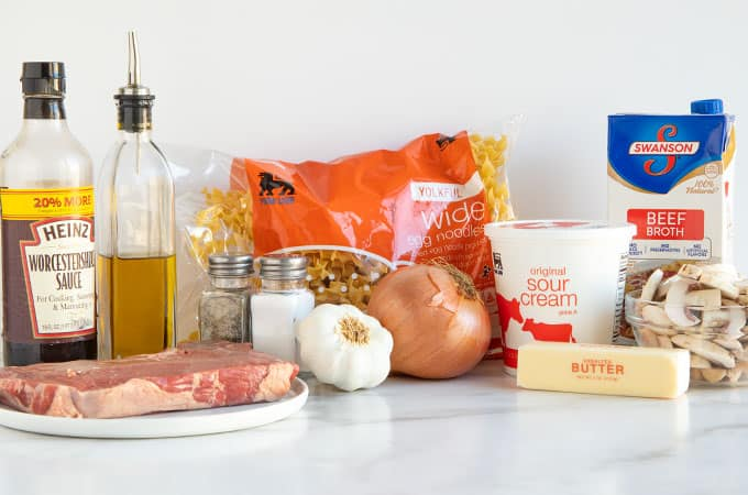 Ingredients for beef stroganoff on a marble surface