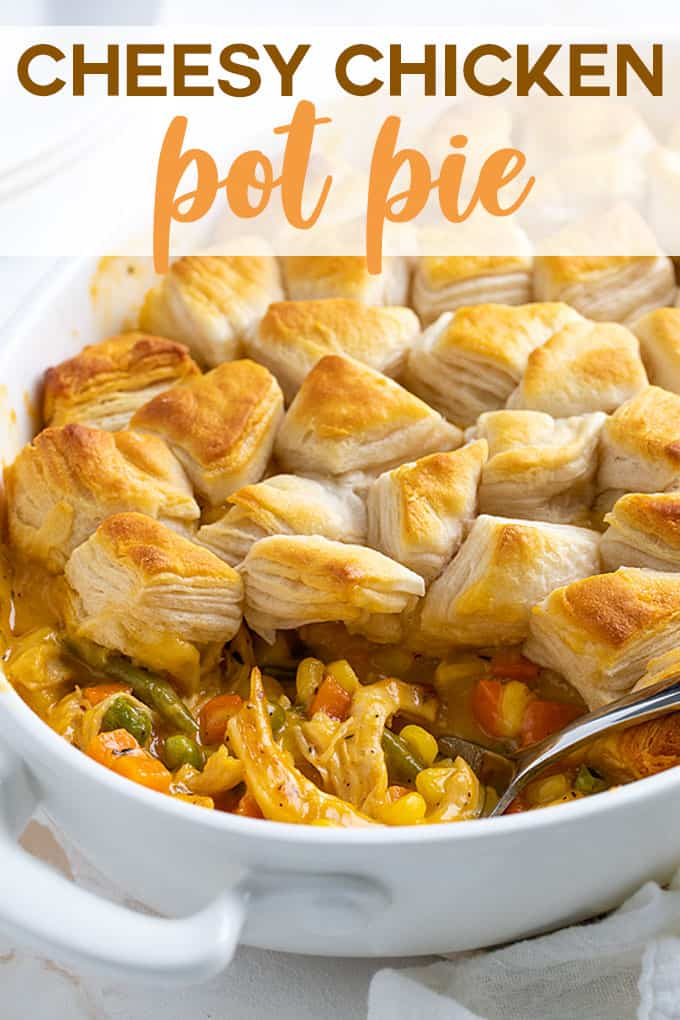 Chicken pot pie with cheese in a white oval baking dish with a serving spoon. Overlay text at top of image.