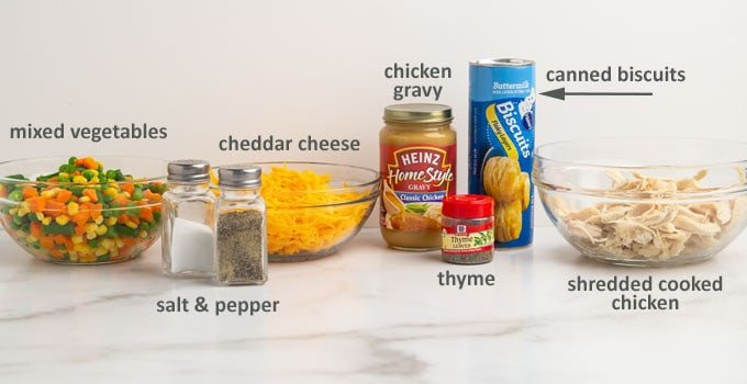 Ingredients for a chicken pot pie with cheese and canned biscuits