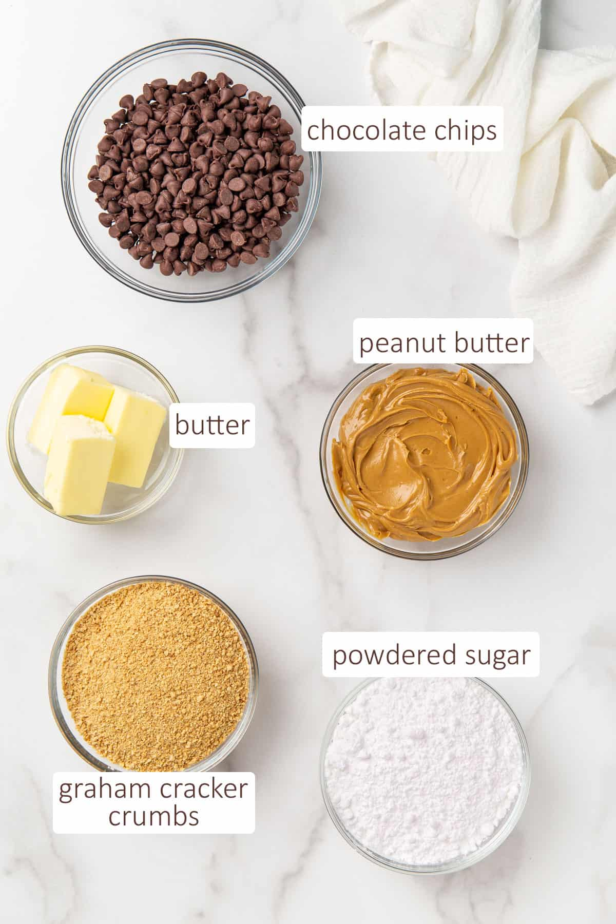 Overhead view of bowls of ingredients for chocolate peanut butter bars.