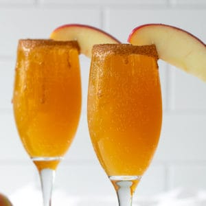 Front view of two mimosas on a white tile background.