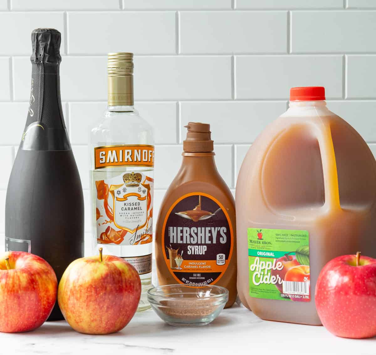 Front view of ingredients for making caramel apple mimosas.