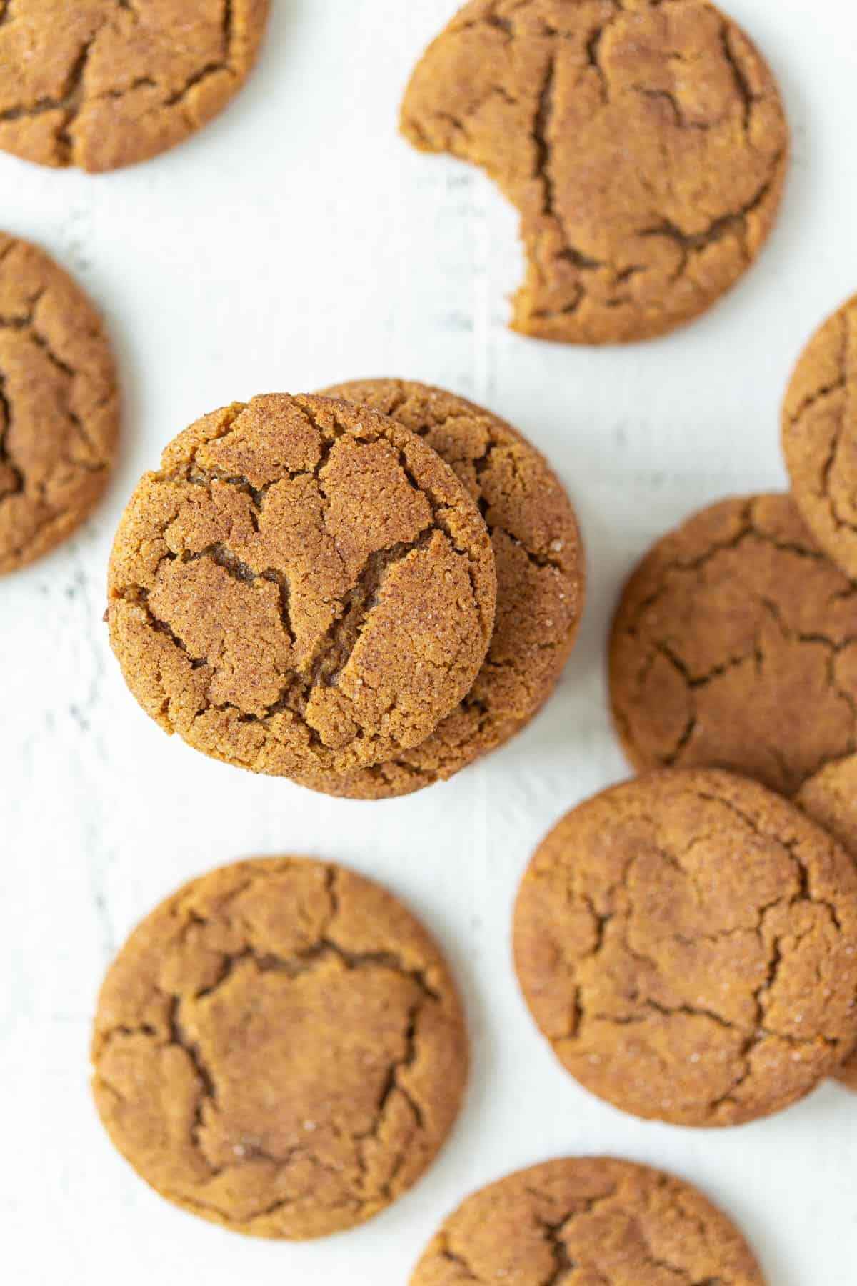 Overhead view of gingersnap cookies on a white surface.