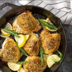 Baked chicken thighs in a cast iron skillet with overlay text.