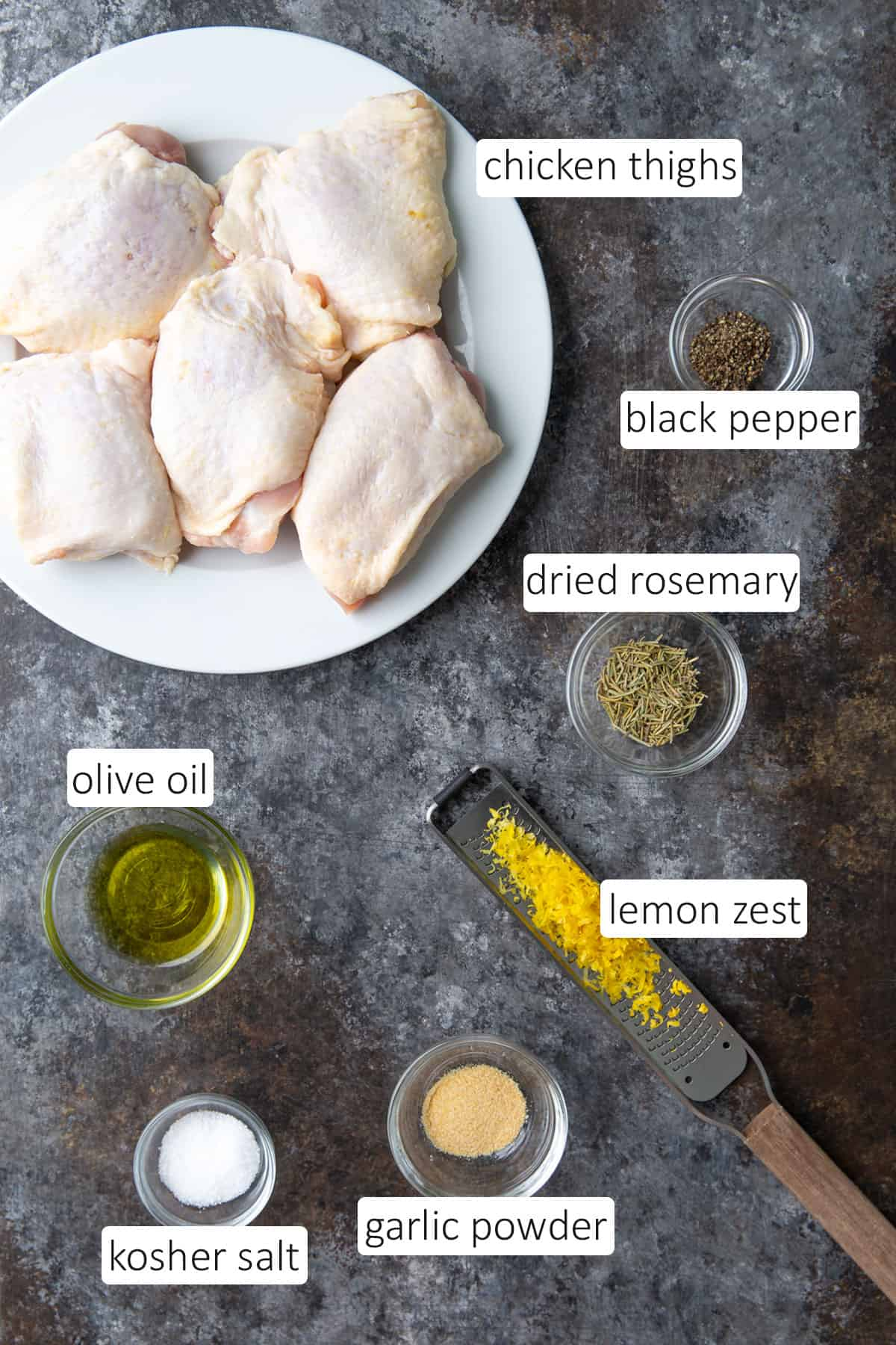 Overhead view of ingredients needed for lemon rosemary chicken thighs.