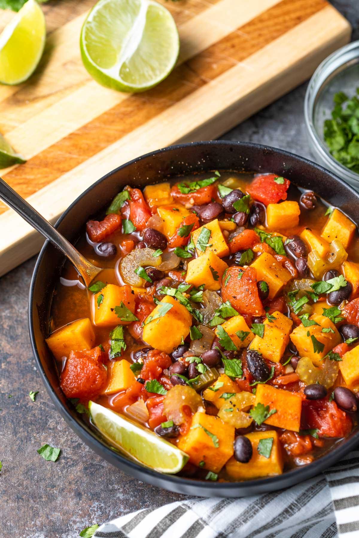 Overhead closeup of a bowl of sweet potato and black bean chili.